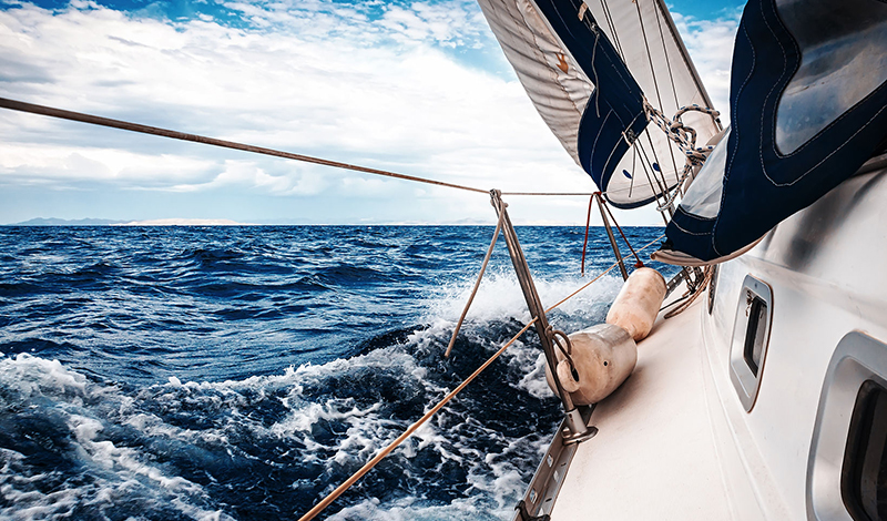 35811077 - the white sails of yachts on the background of sea and sky in the clouds