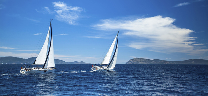 39326686 - sailing in the wind through the waves at the aegean sea in greece.