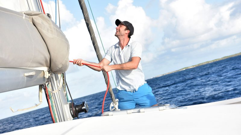 50065389 - man pulling on rope to sail out
